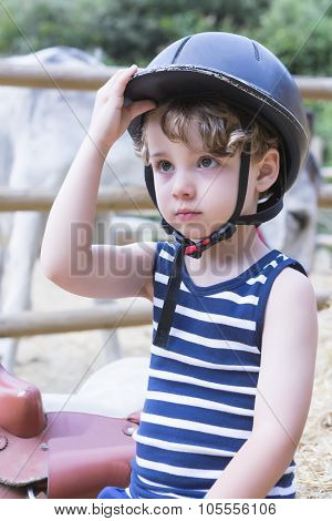 Boy Rider Adjusts His Helmet.
