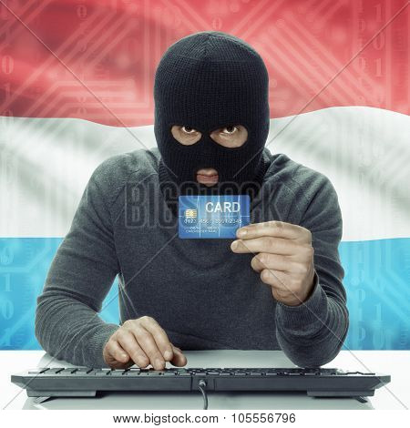 Dark-skinned Hacker With Flag On Background Holding Credit Card - Luxembourg