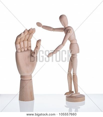 Wooden Dummy And A Symbol Of The Hand Prosthesis. On A White Background.