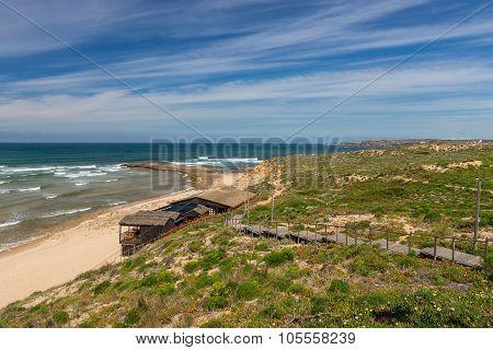 Seascape Of The Portuguese Village In The Summer. Villa Milfontes.