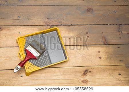 Wooden Plank Floor Varnishing. Gray Varnish And Paintbrush In Tray