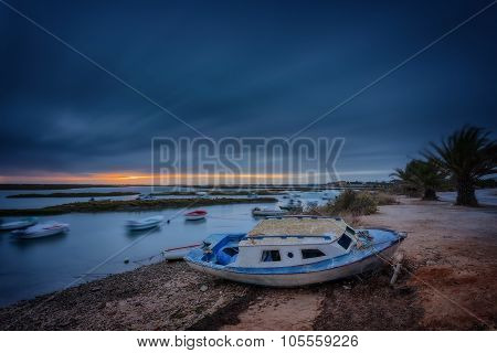 Dramatic Seascape Sunset Views. Fishing Boat In The Foreground.