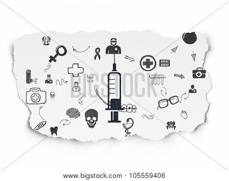 Health concept: Syringe on Torn Paper background
