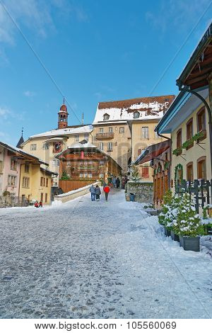 View Of The Main Street In The Swiss Town Gruyeres Decorated For Christmas
