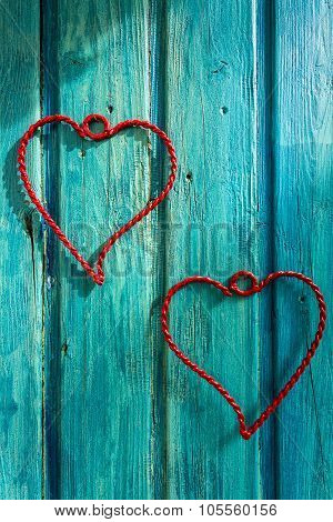 Heart Of Wire On A Wooden Vintage Wood. For Lovers.