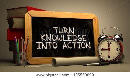 Turn Knowledge into Action Handwritten on Chalkboard.
