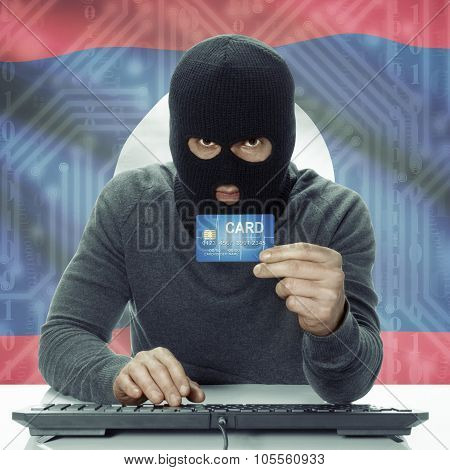Dark-skinned Hacker With Flag On Background Holding Credit Card - Laos