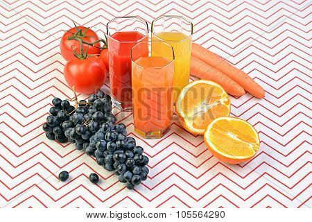 Fruit, vegetable, juice in glasses fresh fruits on table