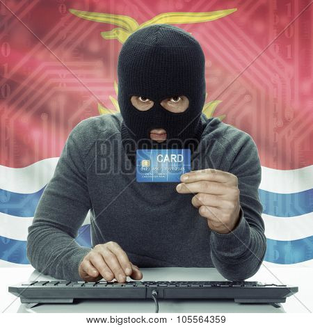Dark-skinned Hacker With Flag On Background Holding Credit Card - Kiribati