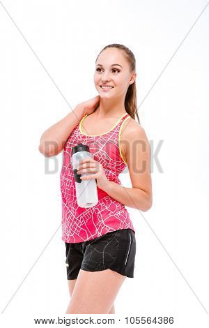 Portrait of a smiling sports woman holding shaker and looking away isolated on a white background