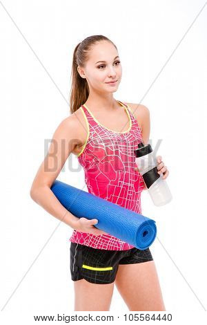 Portrait of a happy woman with shaker and yoga mat isolated on a white background