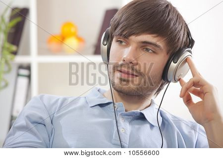Man Hearing Music At Home