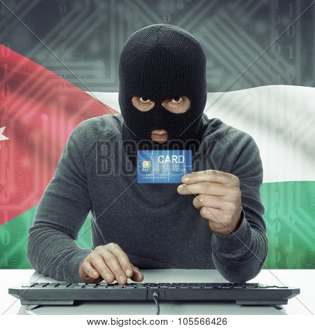 Dark-skinned Hacker With Flag On Background Holding Credit Card - Jordan
