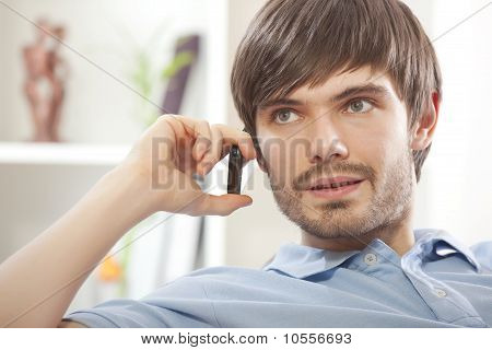 Man With Cell Phone At Home