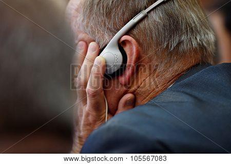Man Using Translation Headphones