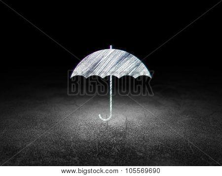 Privacy concept: Umbrella in grunge dark room