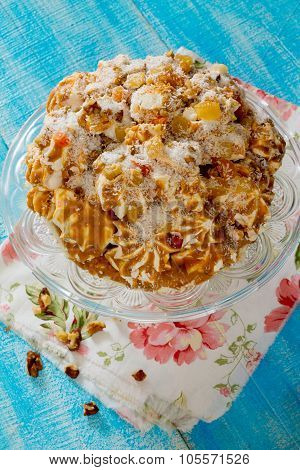Meringue Cake With Condensed Milk, Nuts And Candied Fruits.
