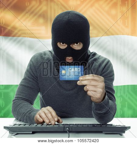 Dark-skinned Hacker With Flag On Background Holding Credit Card - India