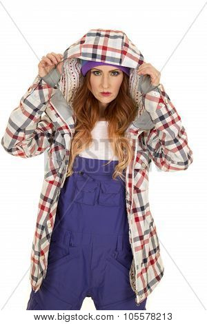 Woman With Red Hair In Coveralls And Hat Hood Up