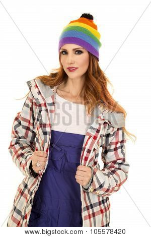 Woman With Red Hair In Coveralls And Hat Stand Smile