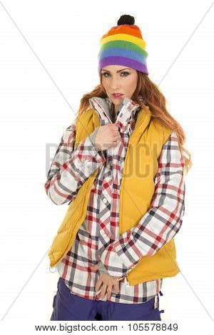 Woman With Red Hair In Yellow Vest And Hat Look