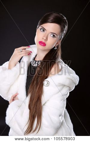 Beauty Fashion Model Girl In White Mink Fur Coat. Luxury Winter Woman With Makeup Isolated On Black