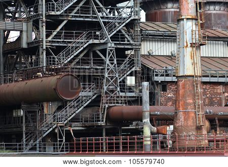 The Flanges And Old Metal Constructions In Industrial Zone