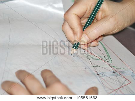 The Woman Hands Tracing The Sewing Drawing