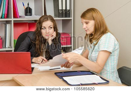 Girl Leafing Through Paper Documents At The Reception Office Specialist