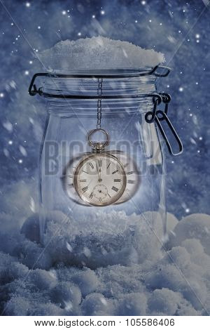 Midnight pocket watch in snow setting