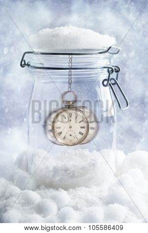 Pocket watch showing midnight on Christmas Eve with snowfall