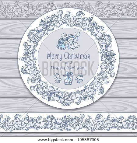 Circle frame and border from Christmas  elements on grey wood background