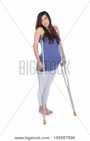 Full Length Portrait Of A Pregnant Woman Using Crutch , Isolated