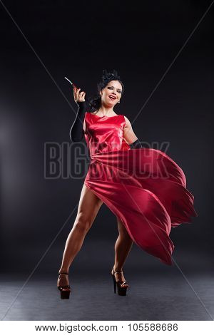 Beautiful Girl In A Red Dress With A Cigarette In Cabaret Style