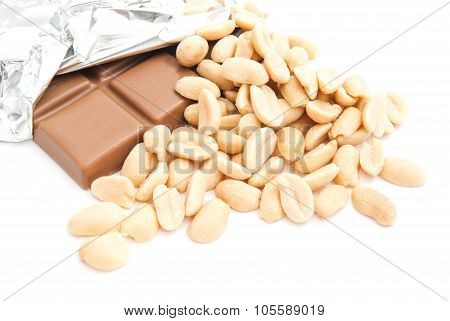 Chocolate Bar And Some Peanuts On White