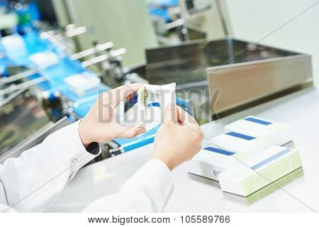 pharmaceutical factory worker at pharmacy industry manufacture packing medicine into boxes