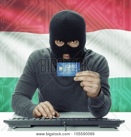 Dark-skinned Hacker With Flag On Background Holding Credit Card - Hungary