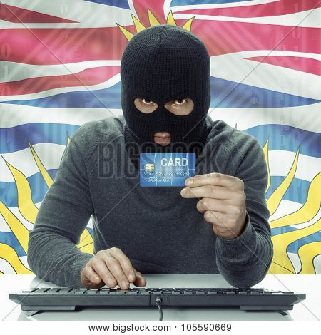 Dark-skinned Hacker With Canadian Province Flag On Background Holding Credit Card - British Columbia