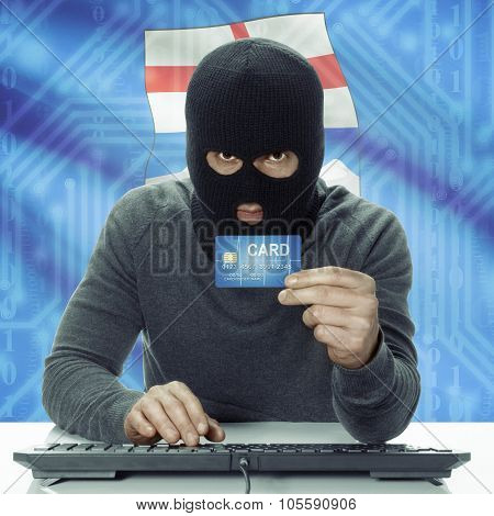 Dark-skinned Hacker With Canadian Province Flag On Background Holding Credit Card - Alberta