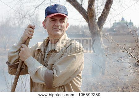 Worker In Garden