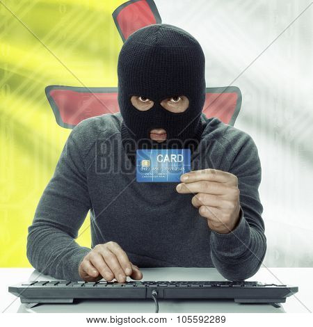 Dark-skinned Hacker With Canadian Province Flag On Background Holding Credit Card - Nunavut