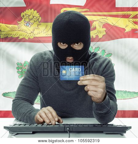 Dark-skinned Hacker With Canadian Province Flag On Background Holding Credit Card - Prince Edward Is