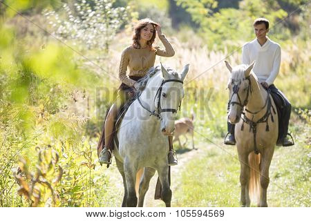 Young couple riding