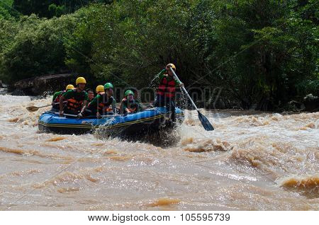 People In Action At Rafting Adventure
