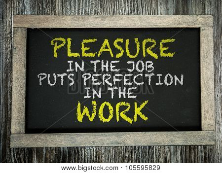 Pleasure in the Job Puts Perfection in the Work written on chalkboard