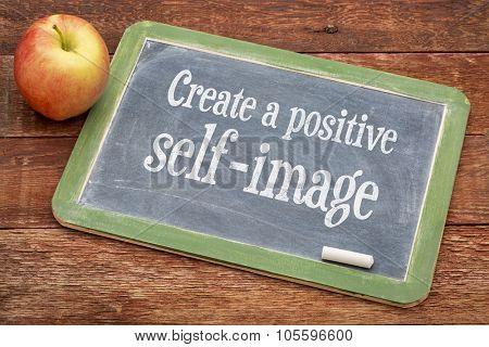 Create positive self image - inspirational words on a slate blackboard against red barn wood