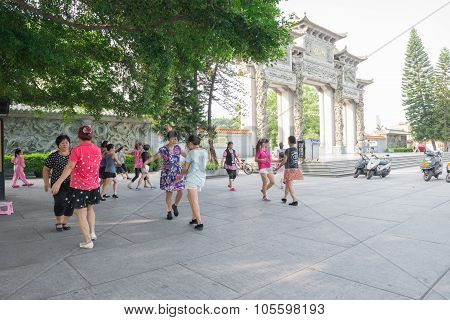 Zhongshan Guangdong China - Aug 22, 2015: A Group Of Chinese Women Dancing In Front Of A Park In The