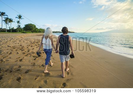 Couple in love walking along the beach together in Maui, Hawaii