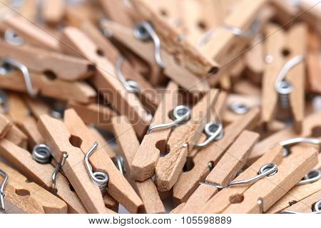 A Solid Background Of Wooden Clothes Pins