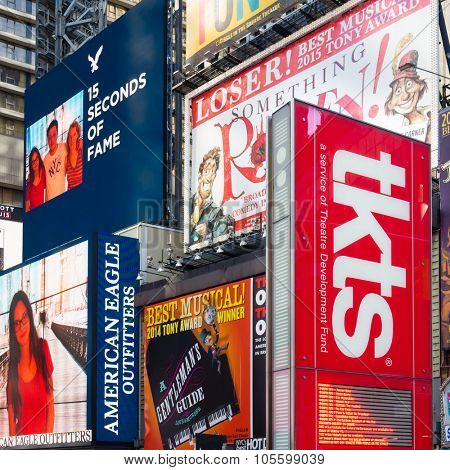 NEW YORK,USA - AUGUST 14,2015 : Billboards on Times Square next to the TKTS booth selling discount tickets to Broadway shows